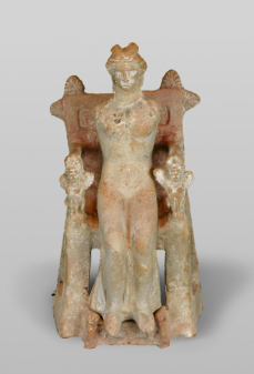 Terracotta figure of woman or goddess seated on a throne