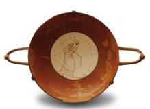 kylix-Girl-playing-with-a-spinning-top